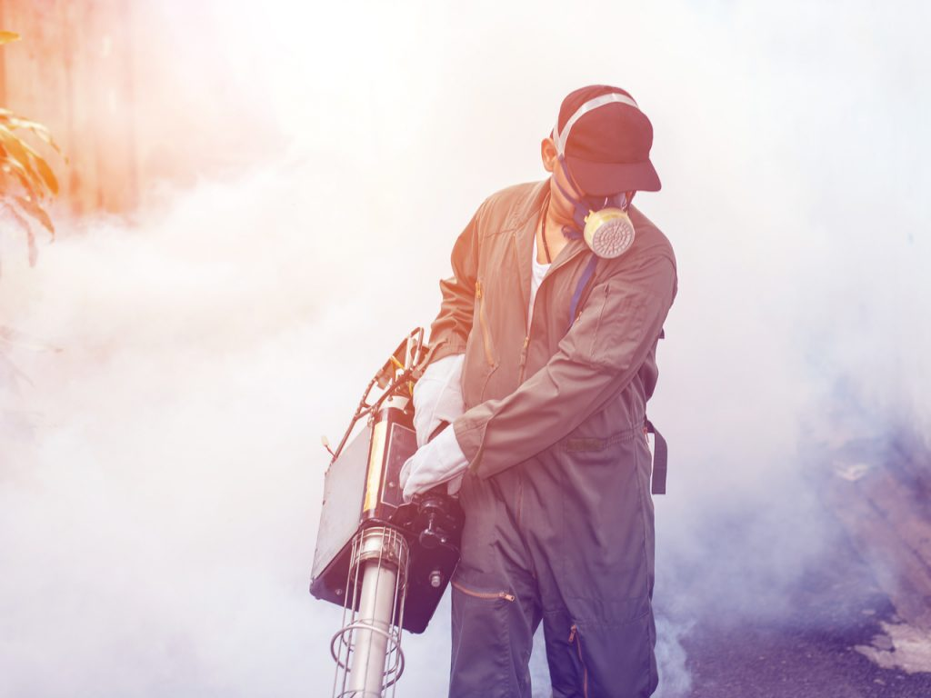 Blurred Of Man Work Fogging To Eliminate Mosquito