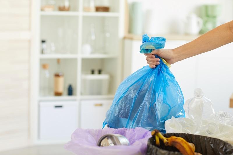 Woman throwing garbage into the bin