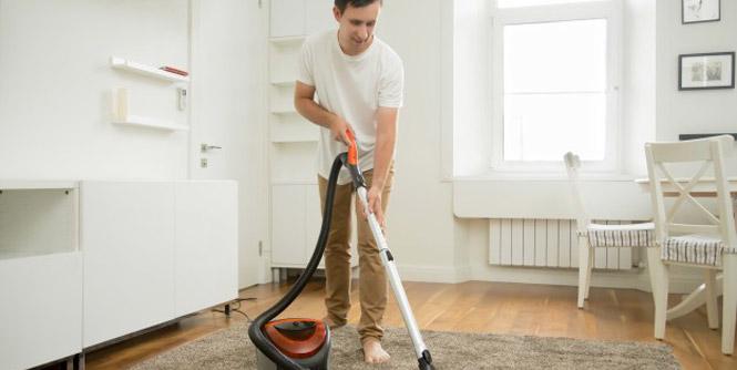 man using vacuum